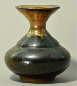 BERNARD LEACH (1887-1997) for Leach Pottery; a stoneware vase of squat form with flared rim