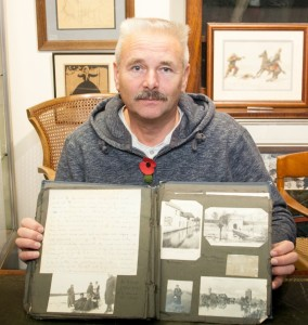 Militaria expert Adrian Stevenson with the scrapbook
