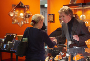 Matthew Foster discussing art deco jewellery with a customer