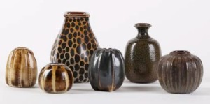 A collection of Martinware small pots