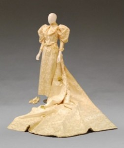 A complete wedding gown ensemble, c.1895, in ivory silk damask.