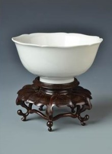 A Chinese Yongzheng white porcelain moulded lotus flower bowl in Ming Yongle style,