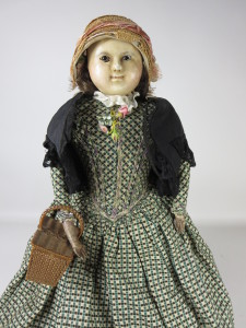 A large wax doll