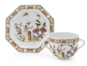A rare Meissen octagonal two-handled beaker and saucer
