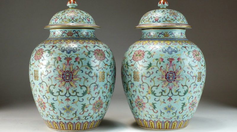 The pair of 19th century famille rose porcelain vases and covers