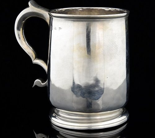 A George I silver mug with ÔÇÖSÔÇÖ scroll handle on a round foot, by renowned London silversmith William Packman, c1722, sold for -ú380
