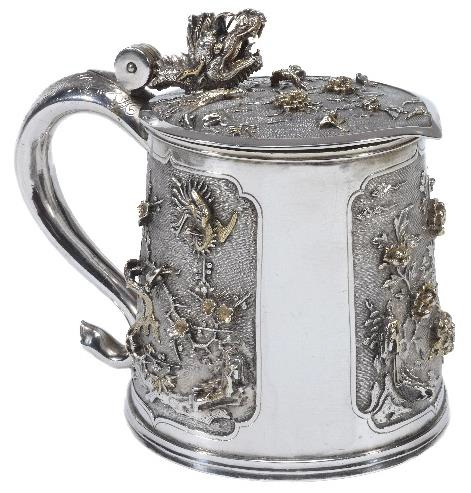 A silver tankard in chinoiserie style