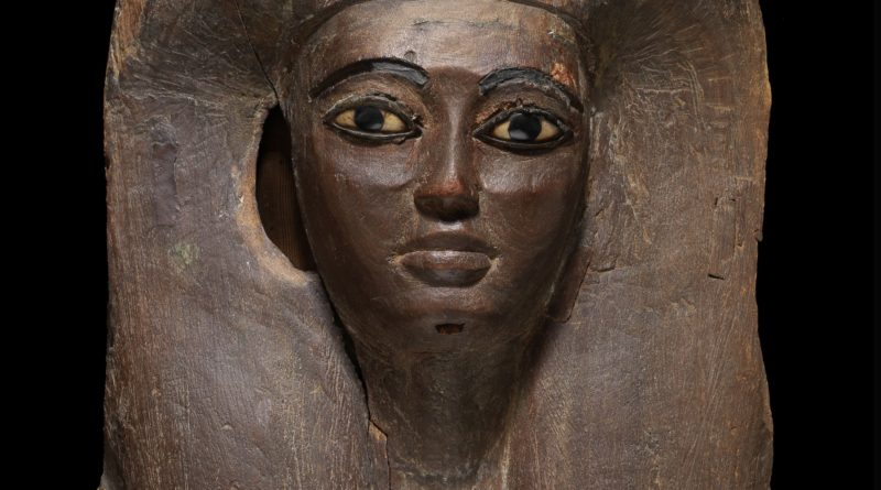An Egyptian wood mummy mask