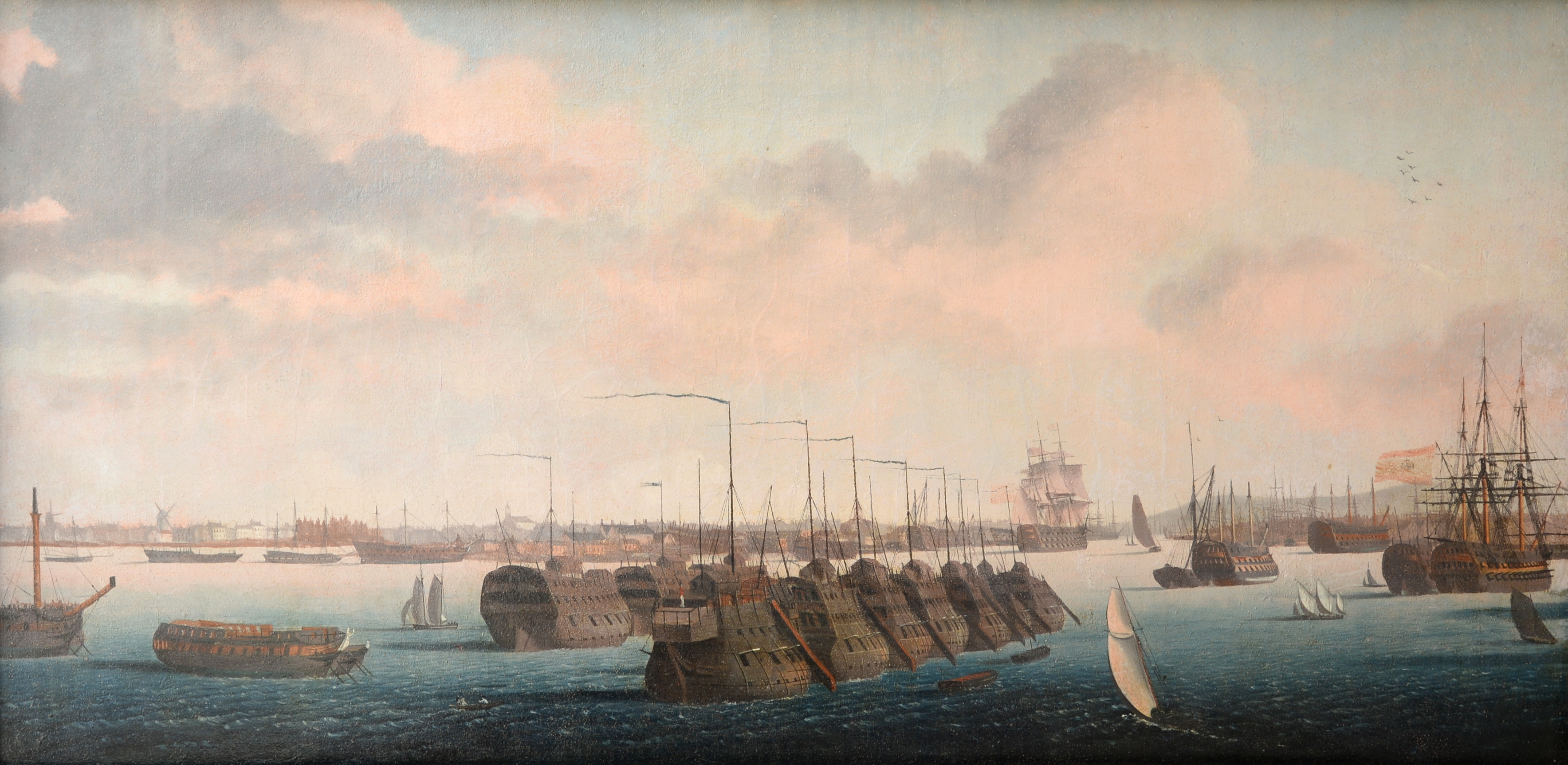 An oil-on-canvas by Garnerary depicting prison hulks lying in Portsmouth Harbour, has a sale estimate of -ú3,000 and -ú5,000