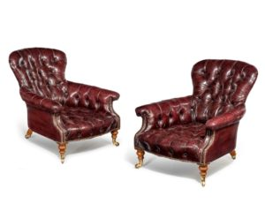 A pair of mid-Victorian walnut low club chairs