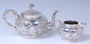 Chinese silver teapot with matching cream jug