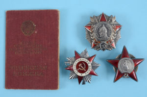 a group of medal s awarded to Platoon Commander Vladimir Venidiktovich Shkil