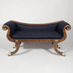 English Regency period mahogany and brass inlaid sabre-legged window seat
