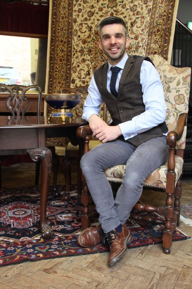Aaron Dean on an antique chair