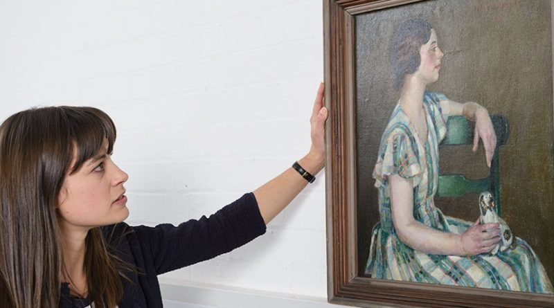 Christies specialist Sarah Reynolds and the painting by Harold C. Harvey
