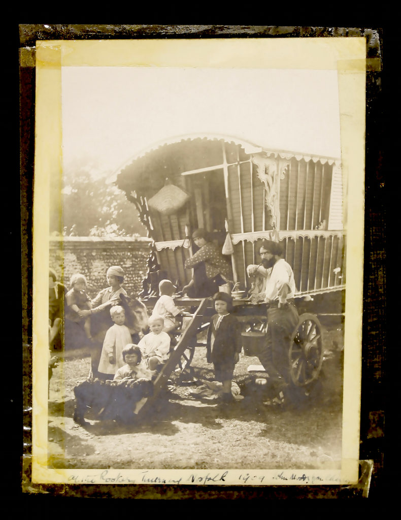 A photograph of the artist August John and his family beside a gypsy caravan