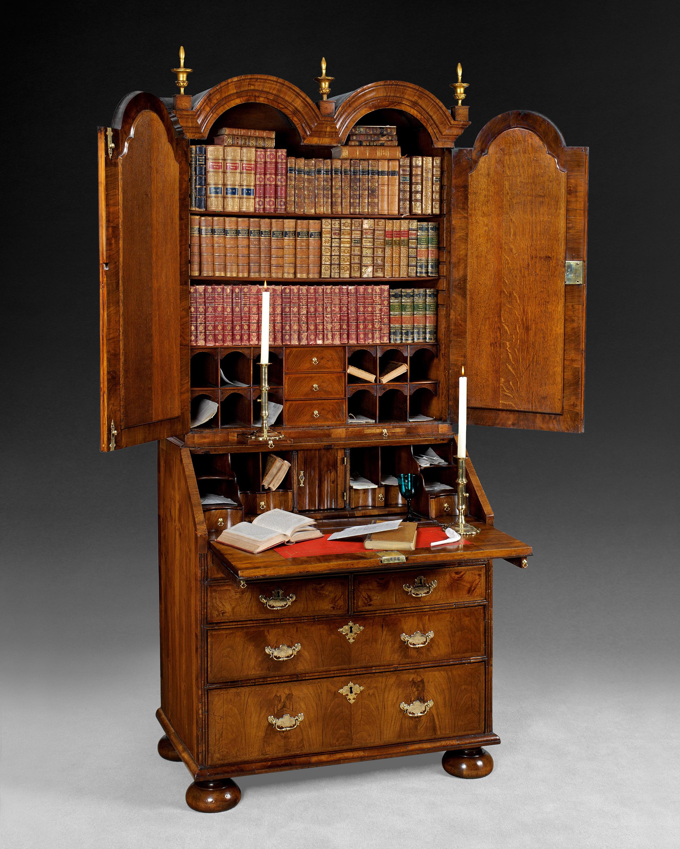 The Queen Anne period figured walnut Double Dome top Bureau Bookcase