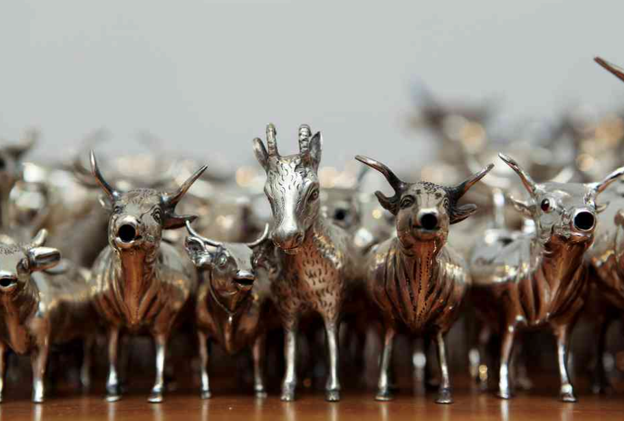 The collection of silver cow creamers