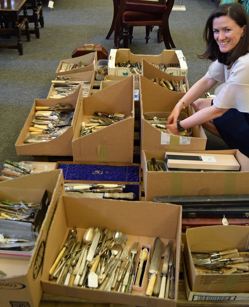 Claire Grindey of Sworders sorts through boxes of cutlery