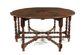 A large 17th century style oak double gate-leg dining table Estimate: £500 - £800